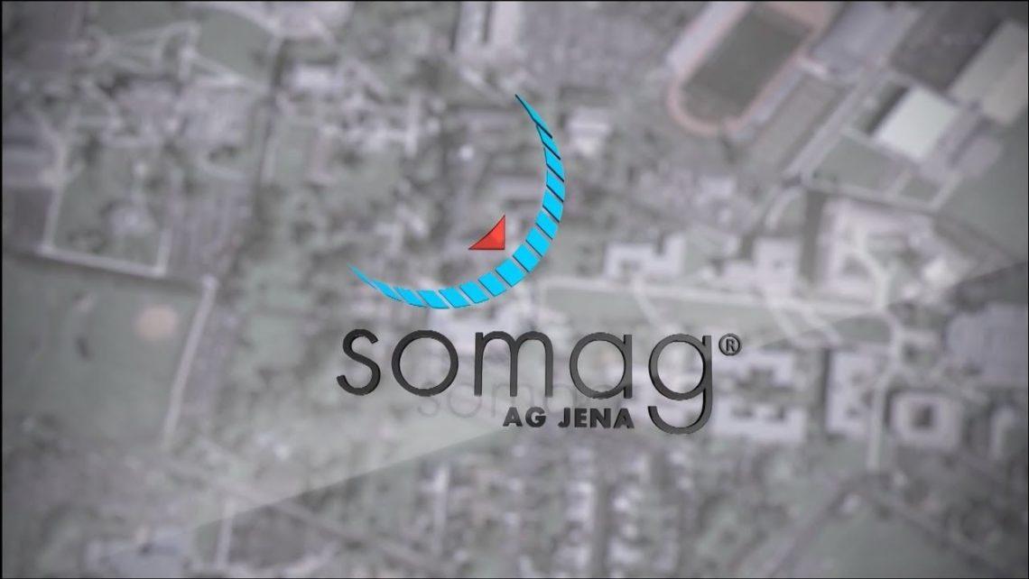 Logo der SOMAG AG mit einer Stadt von oben im Hintergrund.